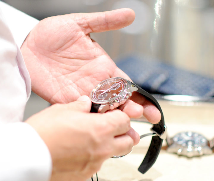Jeweler appraising watches